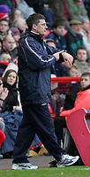 Photo:  Frances Leader.<br /> Charlton v Leicester. FA cup fifth round. <br /> The Valley<br /> 19/02/2005<br /> Leicester's manager Craig Levein checks his watch for the game to end so his team can beat Charlton 2-1