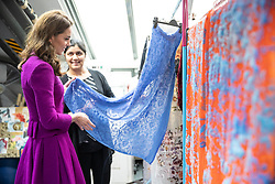 The Duchess of Cambridge in the Dye Department with Parveen Banga, Head of Dye Department. during her visit to the Royal Opera House in London.