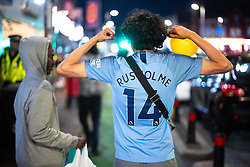 """© Licensed to London News Pictures. 20/07/2021. Manchester, UK. A man wearing a """" RUSHOLME """" Manchester City football shirt . Muslims celebrate Eid al-Adha in Rusholme in Manchester. The festival marks the Islamic tale of the prophet Ibrahim , who offered his son as a sacrifice to Allah . Photo credit: Joel Goodman/LNP"""