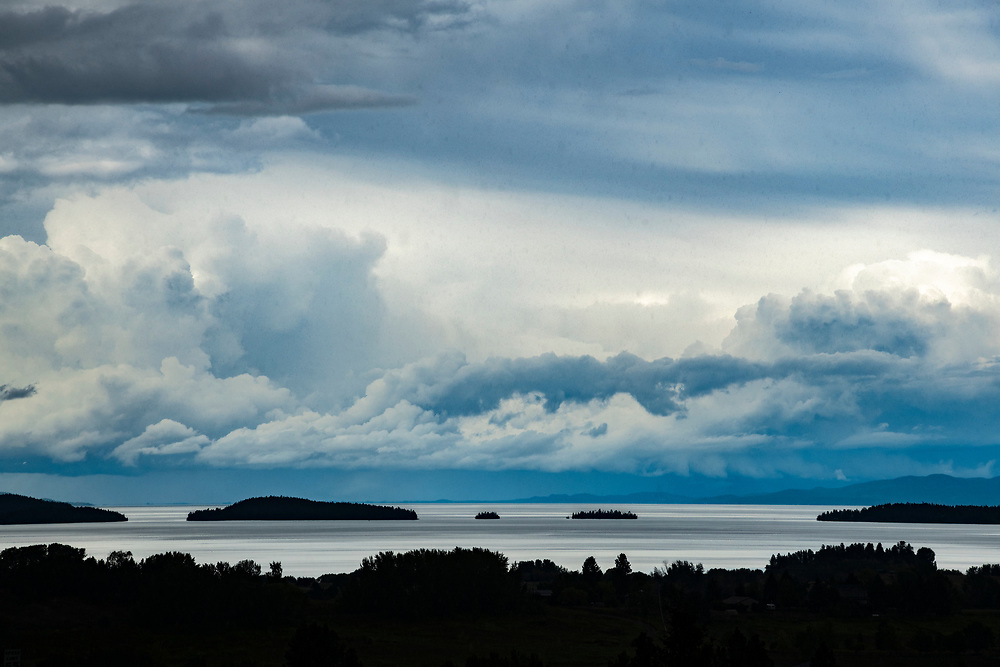 Licensing - Open Edition PrintsA dramatic summer storm rolls across Flathead Lake in Montana with islands and storm clouds