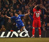 Photo. Daniel Hambury, Digitalsport<br /> Chelsea v Liverpool.<br /> <br /> Carling Cup Final.<br /> 27/02/2005<br /> Chelsea's Metaja Kezman celebrates Liverpool's own goal as Luis Garcia shows dissapointment.