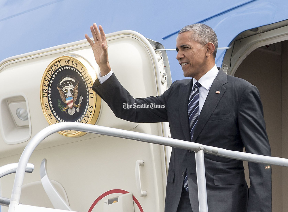 President Barack Obama waves to people waiting for his arrival at Sea-Tac on Friday. (Mike Siegel / The Seattle Times)