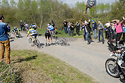France, April 13th 2014: Spectators warn other riders and vehicles of the crash involving Europcar's Bjorn Thurau at Pont Gibus, Wallers, during the 2014 Paris Roubaix cycle race.
