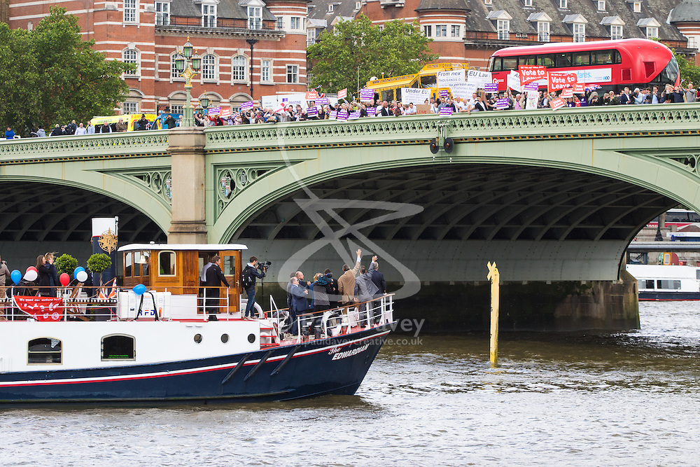 London Bridge, London, June 15th 2016. A flotilla of fishing boats led by UKIP's Nigel Farage heads through Tower Bridge in protest against the EU's Common Fisheries Policy and in support of Britain leaving the EU. PICTURED: Farage's boat passes under Westminster Bridge as supporters cheer and counter protesters jeer.