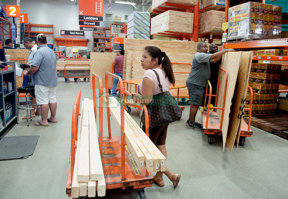 September 4, 2017 - Palm Beach, Florida, U.S. - Customers wait in line to purchase plywood and other products from the lumber department at Home Depot on Palm Beach Lakes in West Palm Beach Monday. Hurricane Irma was upgraded to a Category 4 Hurricane. The storm could potentially hit Florida by next weekend.  (Credit Image: © Meghan Mccarthy/The Palm Beach Post via ZUMA Wire)