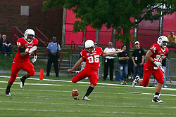 10 September 2011: Jordan Neukirch and Colton Underwood flank Nick Aussieker at a kickoff during an NCAA football game between the Morehead State Eagles and the Illinois State Redbirds at Hancock Stadium in Normal Illinois.