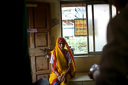 Premi Suvasiya waits to receive her medicine at the Thakkar Bappa DOTS Clinic.