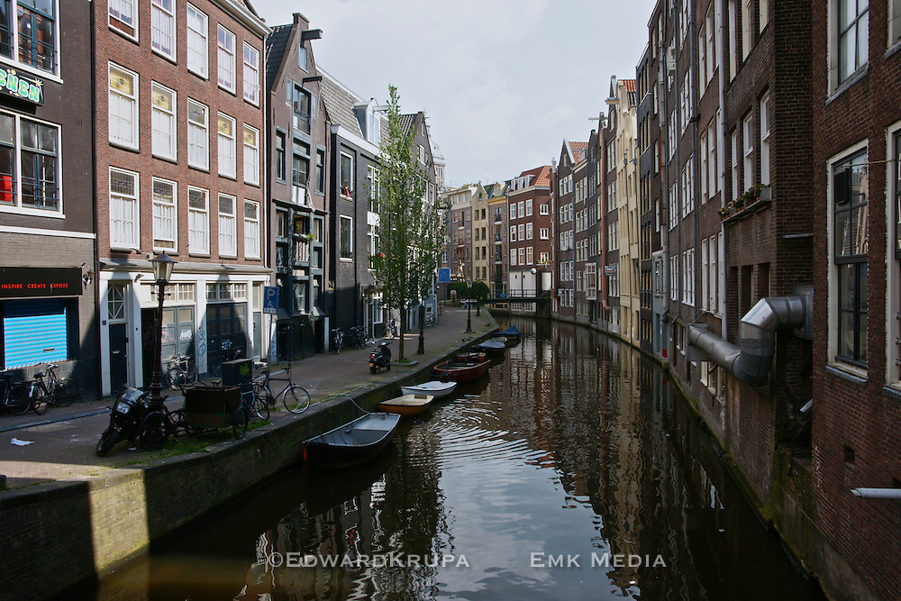 Buildings line a canal in Amsterdam.