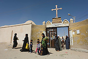 Christian families leave St Tawdros (St Theodore's) Coptic Orthodox Christian Monastery, Luxor, Nile Valley, Egypt. The Copts are an ethno-religious group in North Africa and the Middle East, mainly in the area of modern Egypt, where they are the largest Christian denomination. Christianity was the religion of the vast majority of Egyptians from 400–800 A.D. and the majority after the Muslim conquest until the mid-10th century. Today, there are an extimated 9-15m Copts in Egypt.