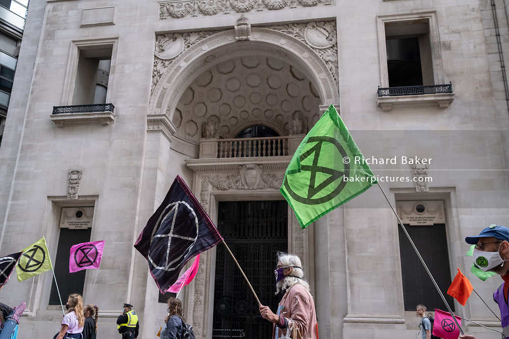 """Climate Change activists take their Environmental and Economy protest called 'The Walk of Shame' to the City of London, the capital's financial district , on 4th September 2020, in London, England. According to XR, """"companies and institutions have profited from the slave trade and the profit from the exploitation of people and the planet. Companies on their tour of City insitutions such as Lloyds of London, Aviva Insurance and the Bank of England, are financing and insuring major fossil fuel projects, fuelling the climate and ecological emergency."""""""