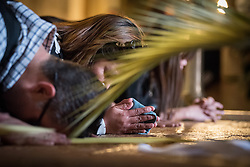 14 April 2019, Jerusalem: Visitors kneel to pray and kiss the Stone of Anointing, where Jesus' body is said to have been anointed before burial in the Church of the Holy Sepulchre, in the Old City of Jerusalem.