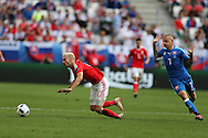 Aaron Ramsey of Wales is fouled by Vladimir Weiss of Slovakia ®. Euro 2016, Wales v Slovakia at Matmut Atlantique , Nouveau Stade de Bordeaux  in Bordeaux, France on Saturday 11th June 2016, pic by  Andrew Orchard, Andrew Orchard sports photography.