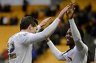 Preston North End defender Adam Reach and Preston North End midfielder Daniel Johnson celebrate the win during the Sky Bet Championship match between Wolverhampton Wanderers and Preston North End at Molineux, Wolverhampton, England on 13 February 2016. Photo by Alan Franklin.