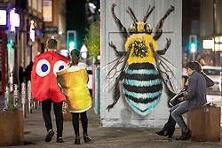 © Licensed to London News Pictures . 28/10/2018. Manchester, UK. A man and a woman in fancy dress in Stevenson Square in the Northern Quarter of Manchester City Centre . Revellers on a night out , many in fancy dress , on the weekend before Halloween . Photo credit: Joel Goodman/LNP