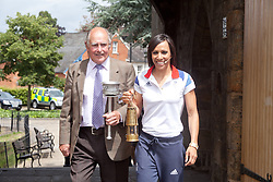 © London News Pictures. 17/07/2012. Tonbridge Castle, Tonbridge, Kent. Dame Kelly Holmes holds the Olympic Flame with Frank Verge who in 1948 ran with the Olympic Torch from Platt to Ightham in Kent, in the gardens of Tonbridge Castle, Kent.  Photo credit should read Manu Paomeque/LNP.