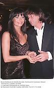 Bruce Robinson & Natalia Estrada. Duckworth Centenary Dinner. Dorchester, London 14/10/98<br />© Copyright Photograph by Dafydd Jones<br />66 Stockwell Park Rd. London SW9 0DA<br />Tel 0171 733 0108