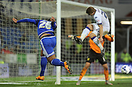 Cardiff City's Kenneth Zohore (l) heads back across goal while being challenged by Leeds United's Gaetano Berardi.  Skybet football league championship match, Cardiff city v Leeds Utd at the Cardiff city stadium in Cardiff, South Wales on Tuesday 8th March 2016.<br /> pic by Carl Robertson, Andrew Orchard sports photography.
