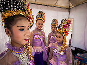 19 APRIl 2014 - BANGKOK, THAILAND: Girls performing traditional Thai folk music wait to go on stage at the Rattanakosin Festival in Bangkok. Rattanakosin is the name of the man made island that is the heart of the old city. Bangkok was formally founded as the capital of Siam (now Thailand) on 21 April 1782 by King Rama I, founder of the Chakri Dynasty. Bhumibol Adulyadej, the current King of Thailand, is Rama IX, the ninth King of the Chakri Dynasty. The Thai Ministry of Culture organized the Rattanakosin Festival on Sanam Luang, the royal parade ground in the heart of the old part of Bangkok, to celebrate the city's 232nd anniversary.    PHOTO BY JACK KURTZ