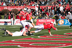 06 November 2010:  Jake Detmers dives for a touchdown after scooping up a blocked punt during a game between the Penguins of Youngstown State and the Redbirds of Illinois State at Hancock Stadium on the campus of Illinois State University in Normal Illinois.