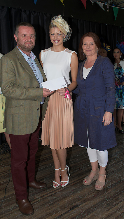 21/09/2014   Repro free   Paul Corson from Dubarry Katie Geoghegan from  Oughterard who won the best dressed lady sponsored by Dubarry with Treena Sweeney from Millars, Clifden  . Photo:Andrew Downes