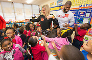 Kami Craig and Wade Smith get a group hug from students during a Touchdown Houston Read On literacy program at Ross Elementary School, December 2, 2016.