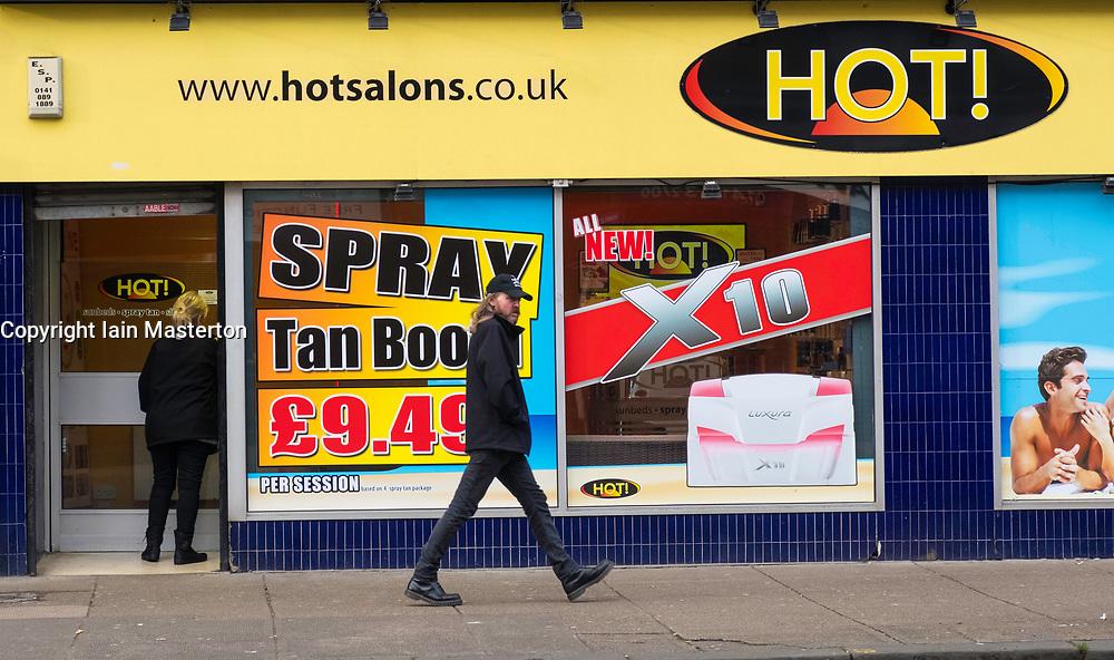 Tanning salon on Victoria Road in Govanhill district of Glasgow, Scotland,United Kingdom