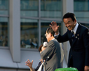 Japan's ruling Liberal Democratic Party (LDP) Presidential election candidates, former Prime Minister Yasuo Fukuda (grey suit, glasses) and current PM Taro Aso,  speak to crowd in central Tokyo, during the campaign for the  election to fill the  position of Japanese Prime Minister vacated by Shinzo Abe  resignation Yasuo Fukuda won the  party election but resignes a year after taking office he was replaced by  Aso.
