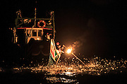 Fish jump toward the sulfur flame in the traditional art of fire fishing. Only 3-4 boats still practice this method of catching fish during the summer months.