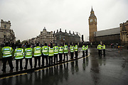 A line of London Policemen stand in Parliament Square, central London to police May day protests.