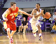 Kansas State guard Mario Taybron (R) drives up court against pressure from Iowa State's John Neal (L) in the second half at Bramlage Coliseum in Manhattan, Kansas, February 8, 2006.  K-State defeated the Cyclones 66-63.