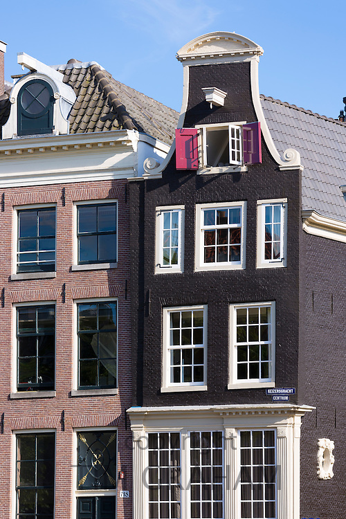 Traditional Dutch architecture - ornate houses at corner of Keizersgracht and Regilersgracht in Amsterdam, Holland