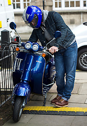 © Licensed to London News Pictures. 16/03/2016. London, UK. Celebrity chef JAMIE OLIVER getting on his scooter In Westminster on the day that George Osborne announced a sugar tax in his budget. Photo credit: Ben Cawthra/LNP