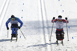 March 14, 2018 - Pyeongchang, GANGWON, SOUTH KOREA - March 14, 2018-Pyeongchang, South Korea- YAROVYI Maksym of Ukraine and SIN Eui Hyun of South Korea action on the slope during an 2018 winter Paralympic Cross-Country Men's 1.1Km Sprint ,Sitting at Alpensia Biathlon Center in Pyeongchang, South Korea. (Credit Image: © Gmc via ZUMA Wire)