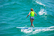 Girl Surfing Waves on a Long Board