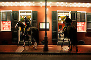 New Orleans mounted patrol officers order takeout from a restaurant on Bourbon Street Friday, Sept. 26, 2008, in the French Quarter of New Orleans, La.<br /> SCOTT MORGAN   ROCKFORD REGISTER STAR