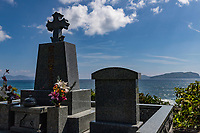 Fuchinomoto Catholic Cemetary, Goto - On the northwestern edge of the Miiraku Peninsula on Fukue Goto Island, the catholic cemetary has tombstones at the Fuchinomoto cemetery overlooking the sea, reflecting the deep Christian faith of the people buried there, when christianity was outlawed in Japan and hidden christians had to practice their faith in secret. Hidden Christians who had migrated from Sotome were finally laid to rest here.