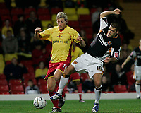 Photo: Marc Atkins.<br /> <br /> Watford v Hull City. Carling Cup. 24/10/2006.<br /> <br /> Darius Henderson of Watford (L) &  John Welsh of Hull battle for the ball.