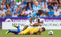"""Chelsea's Alvaro Morata (bottom) and Huddersfield Town's Terence Kongolo battle for the ball during the Premier League match at the John Smith's Stadium, Huddersfield. PRESS ASSOCIATION Photo. Picture date: Saturday August 11, 2018. See PA story SOCCER Huddersfield. Photo credit should read: Mike Egerton/PA Wire. RESTRICTIONS: EDITORIAL USE ONLY No use with unauthorised audio, video, data, fixture lists, club/league logos or """"live"""" services. Online in-match use limited to 120 images, no video emulation. No use in betting, games or single club/league/player publications."""