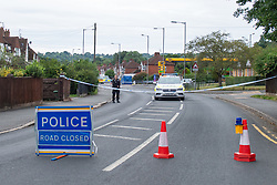 © Licensed to London News Pictures. 31/07/2021. High Wycombe, UK. A police cordon closes a road as a major investigation gets underway in High Wycombe, unconfirmed reports on social media indicate that a person was stabbed to death in the early hours of Sunday morning 31 July 2021. Photo credit: Peter Manning/LNP