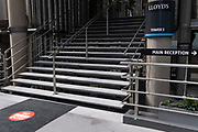 In the week that schools open again, City workers still largely remain working from home during the Coronavirus pandemic, and a circular sign on the ground tells Lloyds of London employees and visiting insurance brokers to use another entrance in Lime Street, on 1st September 2020, in London, England.