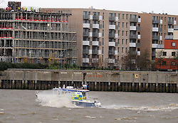 © Licensed to London News Pictures. 05/12/2013<br /> A police boat battles the winds on the Thames as it heads into London at the Thames Barrier.<br /> The Met office has given a severe weather warning for parts of the UK and The Thames Barrier will close at 10pm tonight(05/12/2013) to protect London from a combined high tide and tidal surge in the Thames estuary.<br /> Photo credit :Grant Falvey/LNP