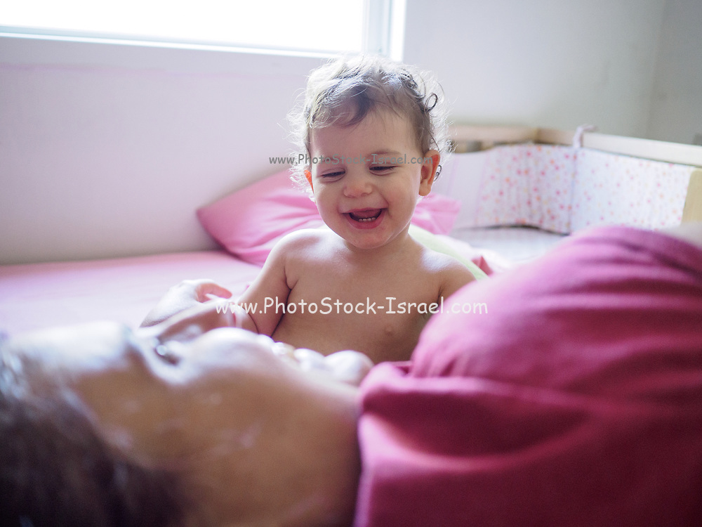 Young toddler interacts with her mother