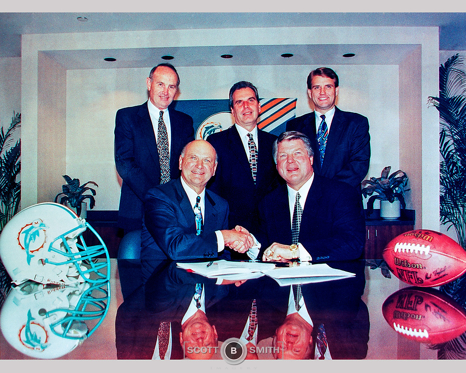 Photographer Dave Cross captures the signing meeting of Jimmy Johnson becoming the new Miami Dolphins head coach.
