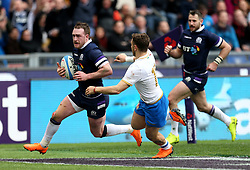 Scotland's Stuart Hogg scores his side's fourth try during the NatWest 6 Nations match at the Stadio Olimpico, Rome.
