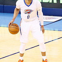 06 May 2016: Oklahoma City Thunder guard Russell Westbrook (0) dribbles during the San Antonio Spurs 100-96 victory over the Oklahoma City Thunder, during Game Three of the Western Conference Semifinals of the NBA Playoffs at the Chesapeake Energy Arena, Oklahoma City, Oklahoma, USA.