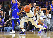 Cartier Diarra #2 of the Kansas State Wildcats chases down a loose ball against the Kansas Jayhawks during the second half at Bramlage Coliseum in Manhattan, Kansas.