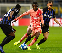 November 7, 2018 - Milan, Italy - Ivan Perisic (R) and Kwadwo Asamoah of Inter Milan vie for the ball with Ousmane Dembele (C) of Barcelona during the Group B match of the UEFA Champions League between FC Internazionale and FC Barcelona on November 6, 2018 at San Siro Stadium in Milan, Italy. (Credit Image: © Mike Kireev/NurPhoto via ZUMA Press)