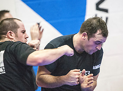 Students warming up punching. Stef Noij, KMG Instructor from the Institute Krav Maga Netherlands, takes the IKMS G Level Programme seminar today at the Scottish Martial Arts Centre, Alloa.
