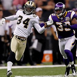 September 9, 2010; New Orleans, LA, USA; New Orleans Saints cornerback Patrick Robinson (34) works against Minnesota Vikings safety Jamarca Sanford (33) on punt coverage during the NFL Kickoff season opener at the Louisiana Superdome. The New Orleans Saints defeated the Minnesota Vikings 14-9.  Mandatory Credit: Derick E. Hingle
