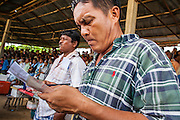 03 NOVEMBER 2012 - HAT YAI, SONGKHLA, THAILAND:  A man keeps track of his bets at the bullfighting arena in Hat Yai, Songkhla, Thailand. Bullfighting is a popular past time in southern Thailand. Hat Yai is the center of Thailand's bullfighting culture. In Thai bullfights, two bulls are placed in an arena and they fight, usually by head butting each other until one runs away or time is called. Huge amounts of mony are wagered on Thai bullfights - sometimes as much as 2,000,000 Thai Baht ($65,000 US).      PHOTO BY JACK KURTZ